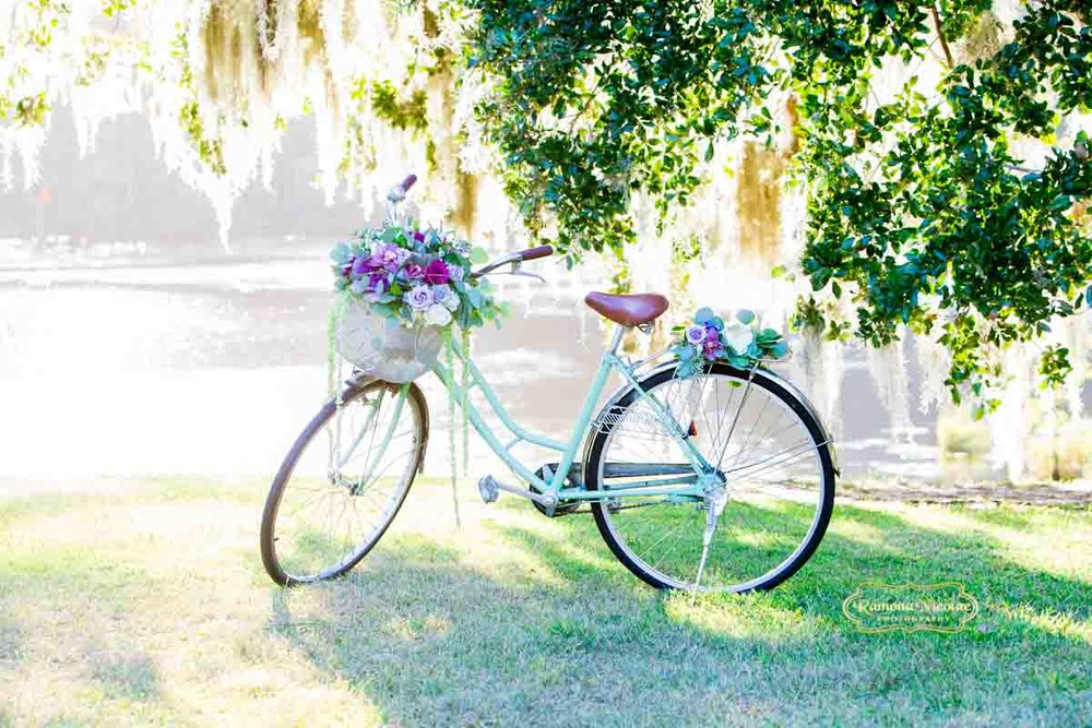 Antique bike we used as prop for bridal pictures at Wachesaw Plantation on the Waccamaw River water banks | Ramona Nicolae Photography | Wedding Photographers Myrtle Beach