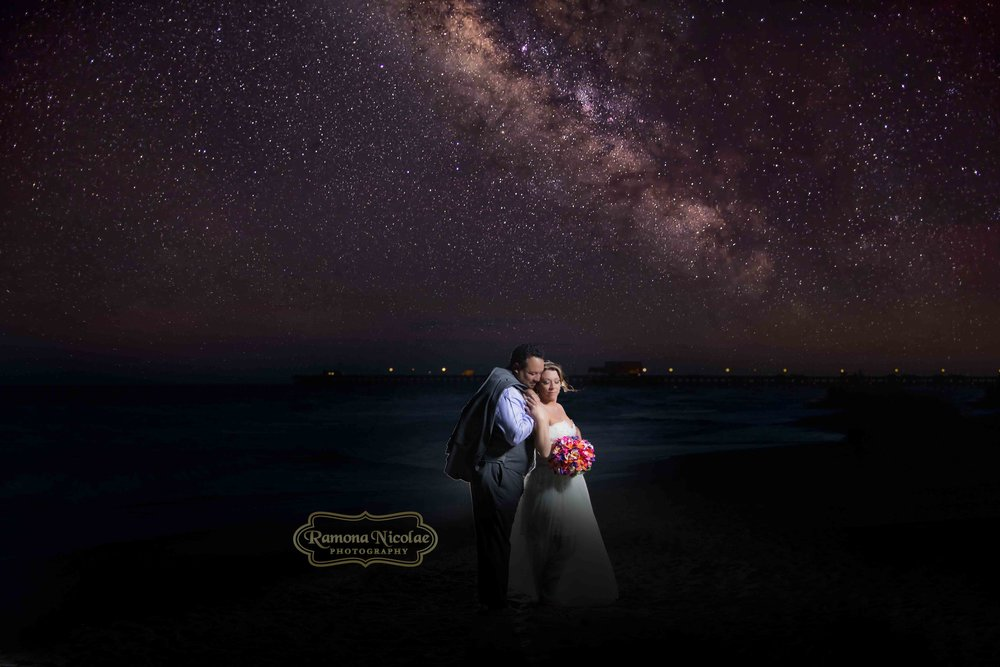 bride and groom with milky way in background by ramona nicolae photography at the hilton in myrtle beach.jpg