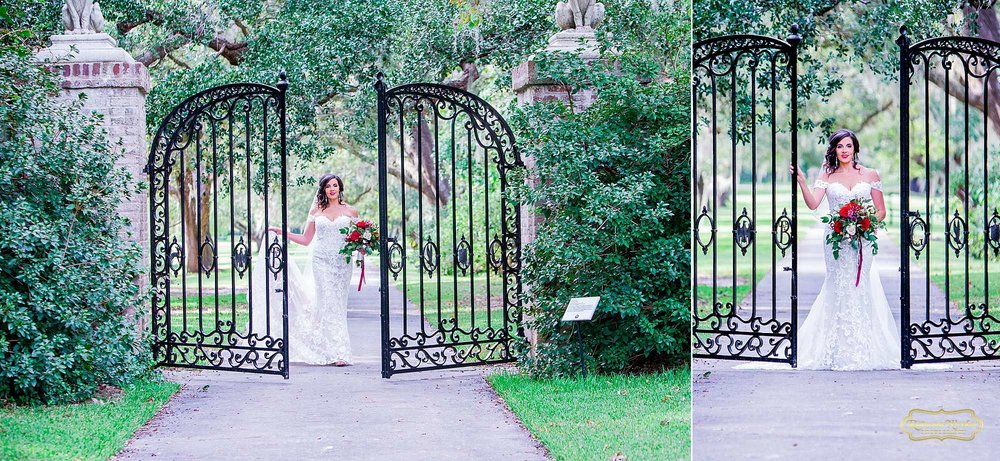 bride with red flowers by the black B & G gates at Brookgreen Gardens looking gorgeous during bridal session with ramona nicolae photography-3.jpg
