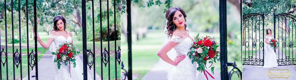 bride with red flowers by the black B & G gates at Brookgreen Gardens looking gorgeous during bridal session with ramona nicolae photography-9.jpg
