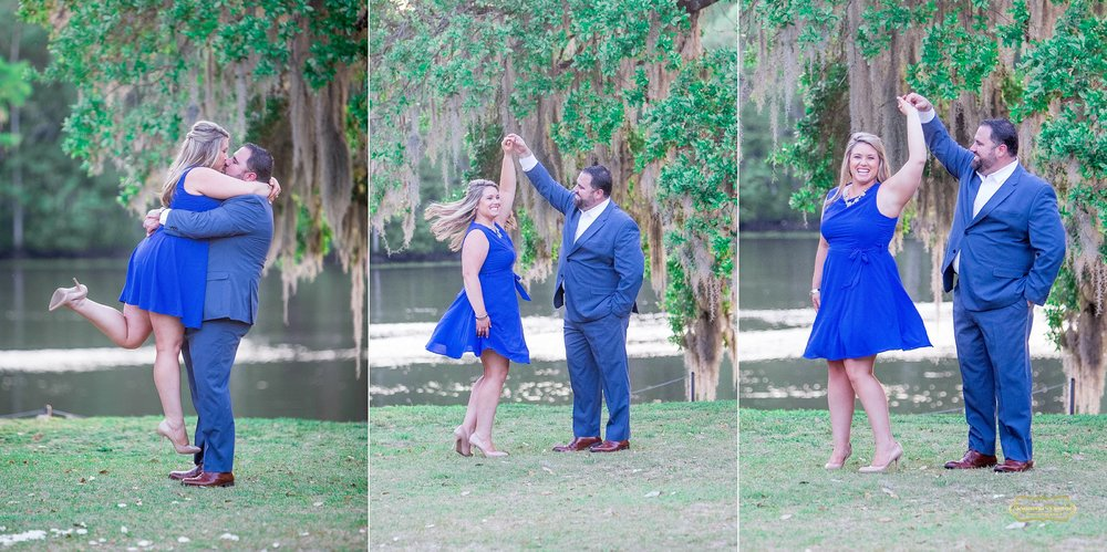 couple hugging and kissing dressed in blue at wachesaw plantation twirling around for engagement pictures with myrtle beach photographer ramona nicolae.jpg
