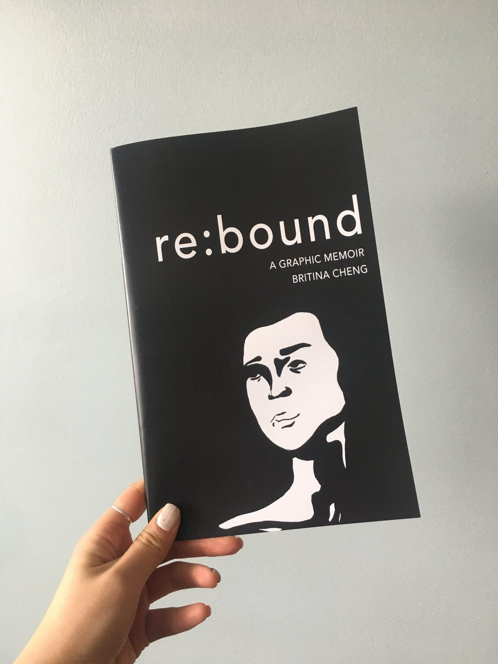 cover: re:bound a graphic memoir by britina cheng