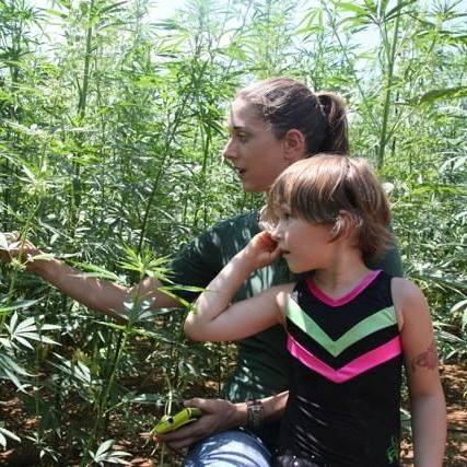Kentucky Hemp Works' founder, Katie Moyer, with her daughter Ayla, in a hemp field