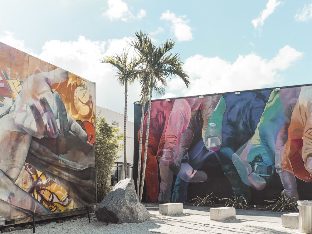 Miami is much more than beaches and tan lines. Wynwood is a thriving art district where everything from buildings to light poles to sidewalks are covered in bright and colorful street art. Take a walk through the neighborhood on your next Miami vacation. #wynwood #wynwoodwalls #miami #streetart