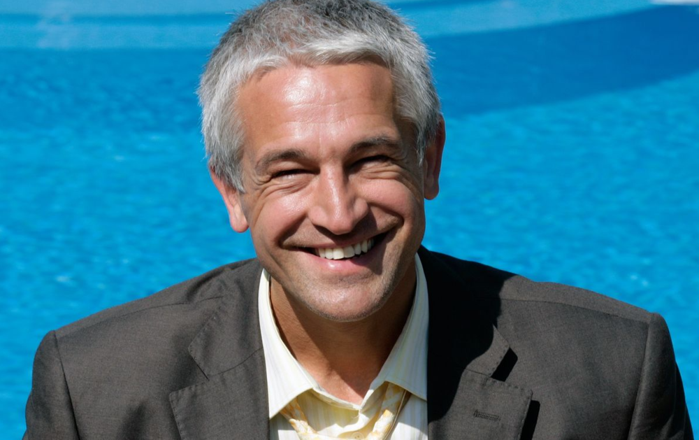 smiling grey haired exec.png