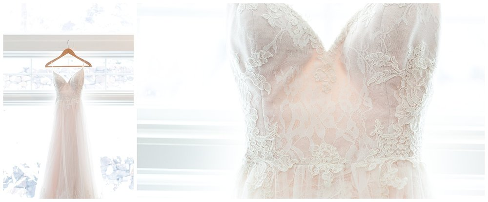 lace detailing on a wedding dress hanging in a window