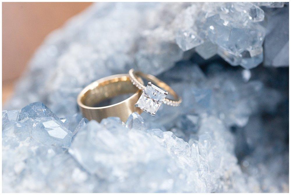 emerald cut diamond ring on a blue geode stone