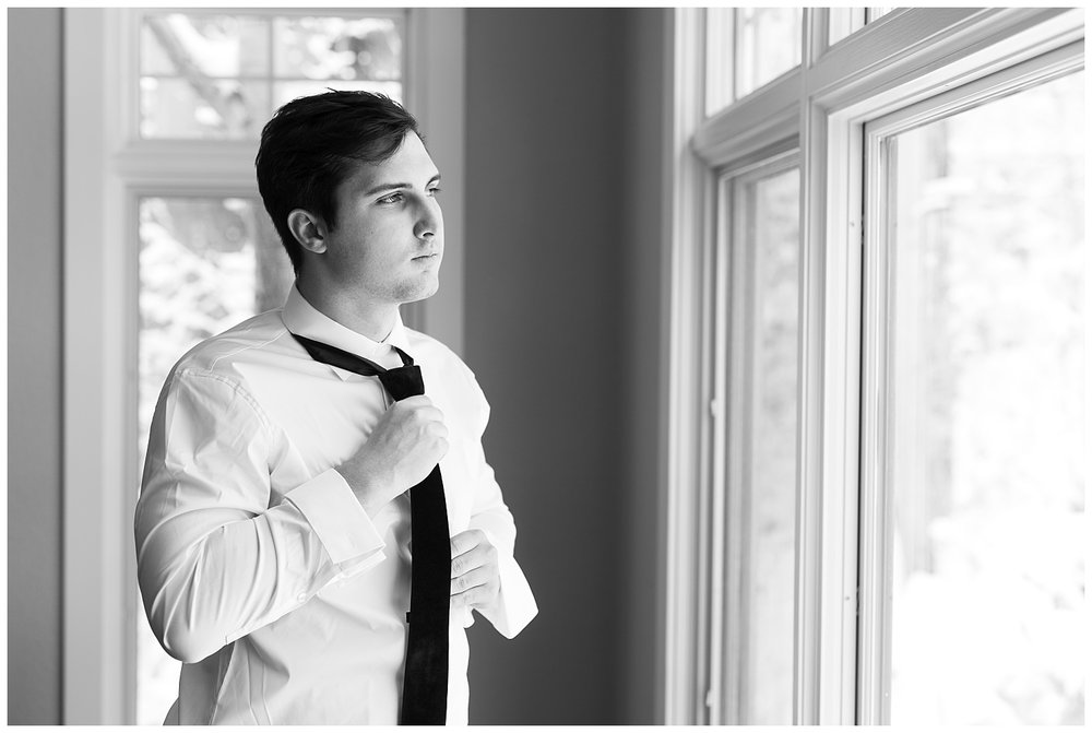 A groom getting ready for his wedding day in Breckendridge, Colorado