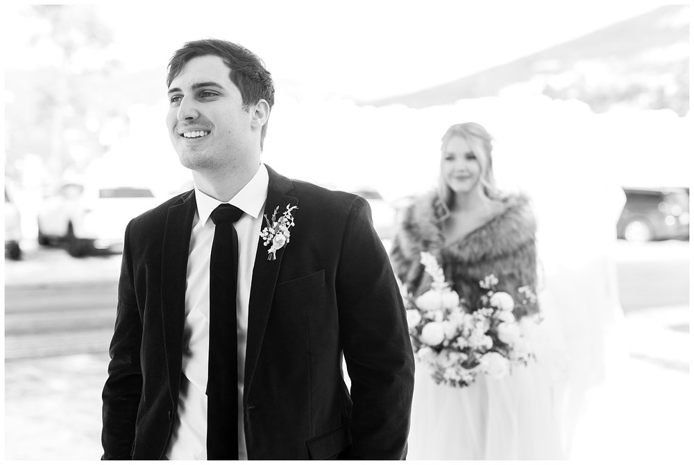 The groom looks excited to see his bride for the first time
