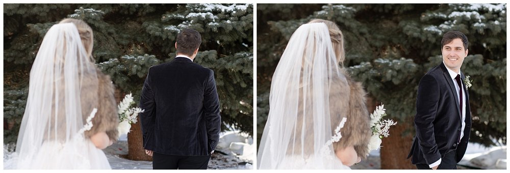 The groom turns around to see his bride on their wedding day