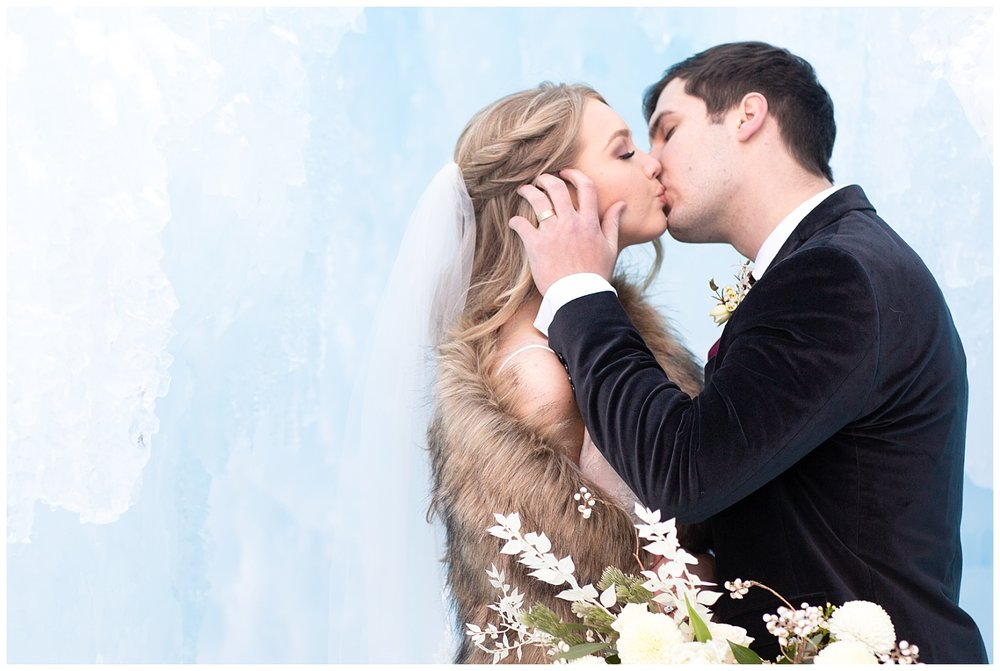 a couple shares a romantic, wintry kiss