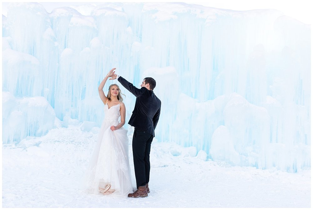 A groom spins his beautiful bride at the Ice Castles in Dillon, Colorado