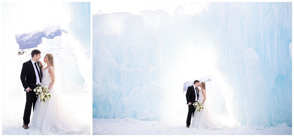 A bride and groom look at each other longingly under an ice sculpture