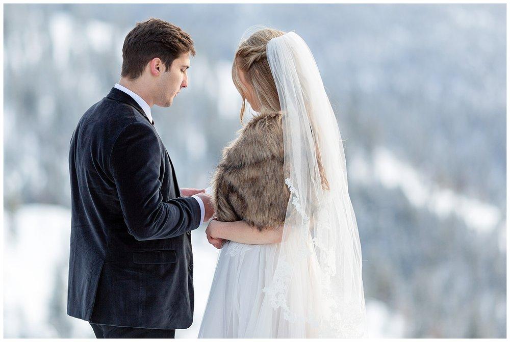 A groom reading his vows to his bride in Breckenridge, Colorado