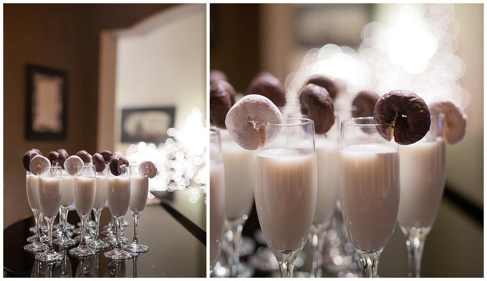 Donuts are rimmed on champagne glasses filled with milk for a cookies and donuts toast