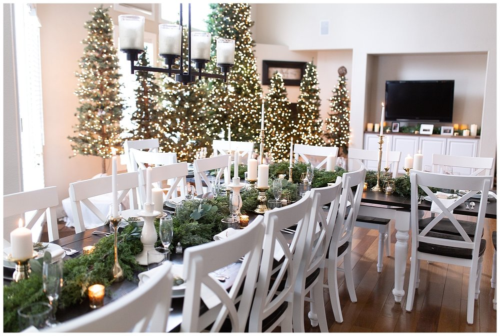 Farm tables decorated with greenery and candlesticks for a wedding
