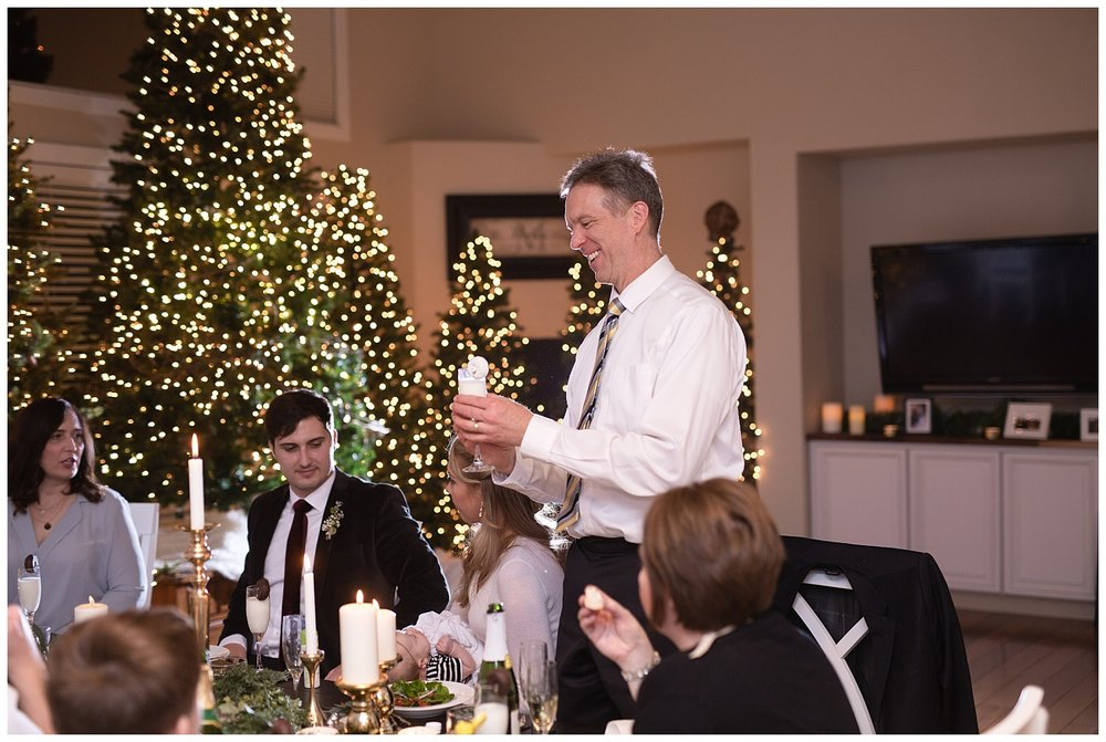 The father of the bride gives a toast with a champagne glass filled with milk