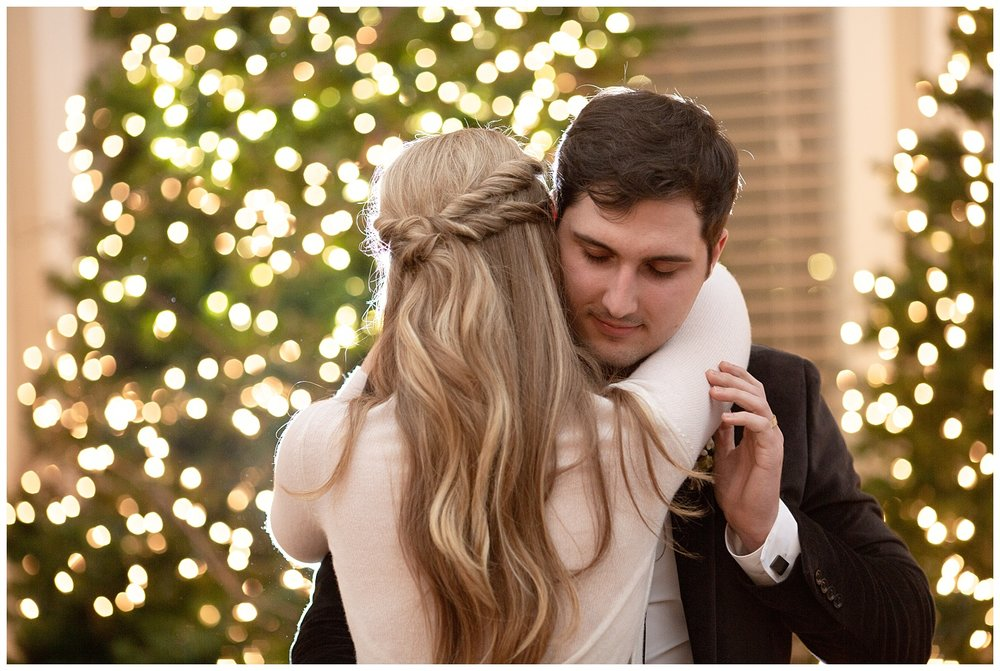 The groom hold his new wife romantically as they dance their first dance