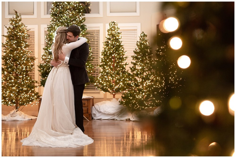 Twinkle lights surround the bride and groom as they dance together