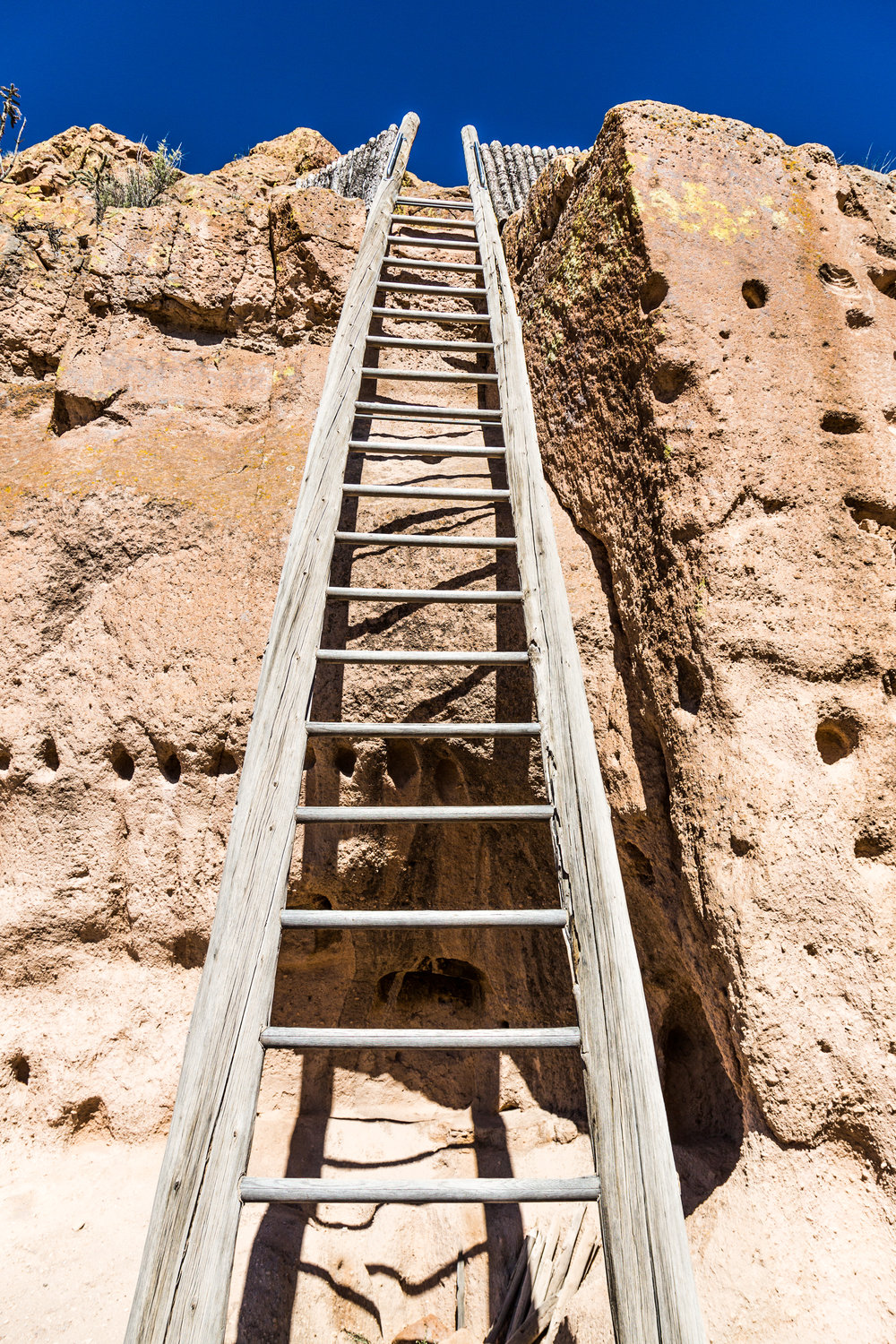 To access the mesa top, the Tewa people had two options: naturally eroded channels or ladders. The water channels are less steep, and are actually used on the tours today. The ladder pictured here is not original.