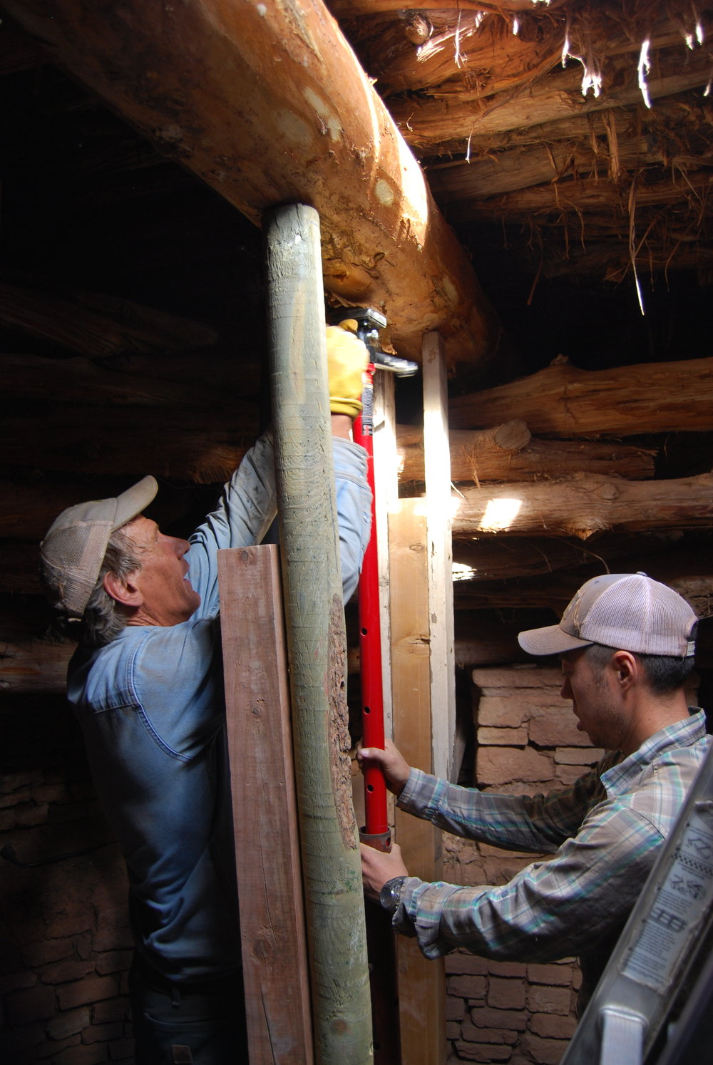 Mark Metteis and Ryan Spittler stabilizing a reconstructed kiva roof.