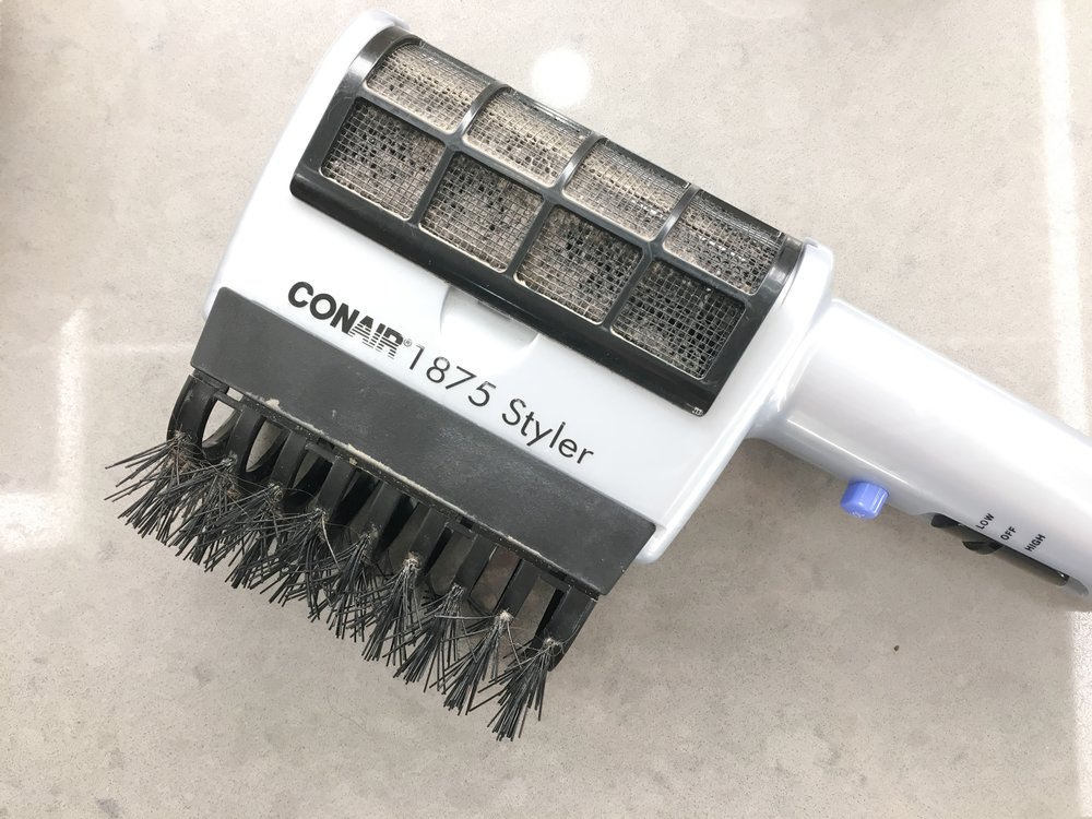 """""""This thing is so worn out and used. But i don't have to carry around too many tools or worry about holding too many things to get my hair dried."""""""