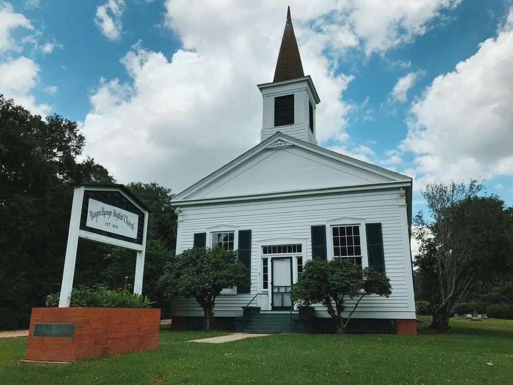 Bayou Rouge Baptist Church in Bunkie, Louisiana. This is the church that my Great-Granddaddy and his family went to. My Grandmother and her siblings would also attend church here when they visited relatives in Bunkie. To the right of the church, is where all of his relatives are buried.