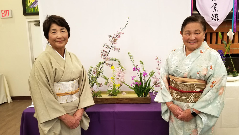 Yaeko Ohta and Karen Morikawa in front of one of the group arrangements.