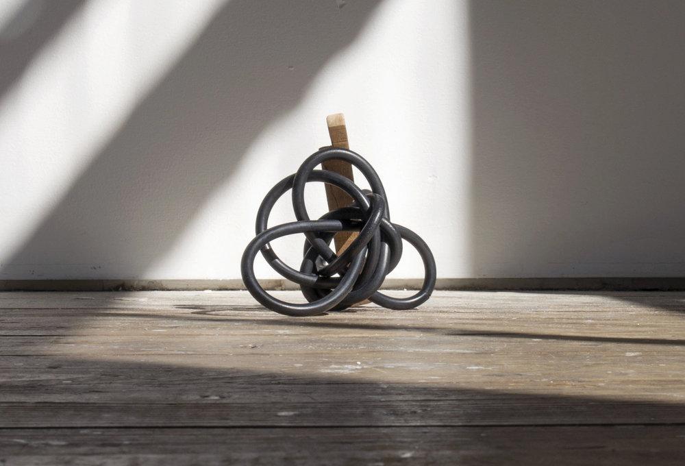 Zoe Knight, Untitled #5 - pool o-ring filter, Silky Oak , 2016,wood, rubber 5cm x 10cm x 5cm. Photo courtesy Carl Warner.