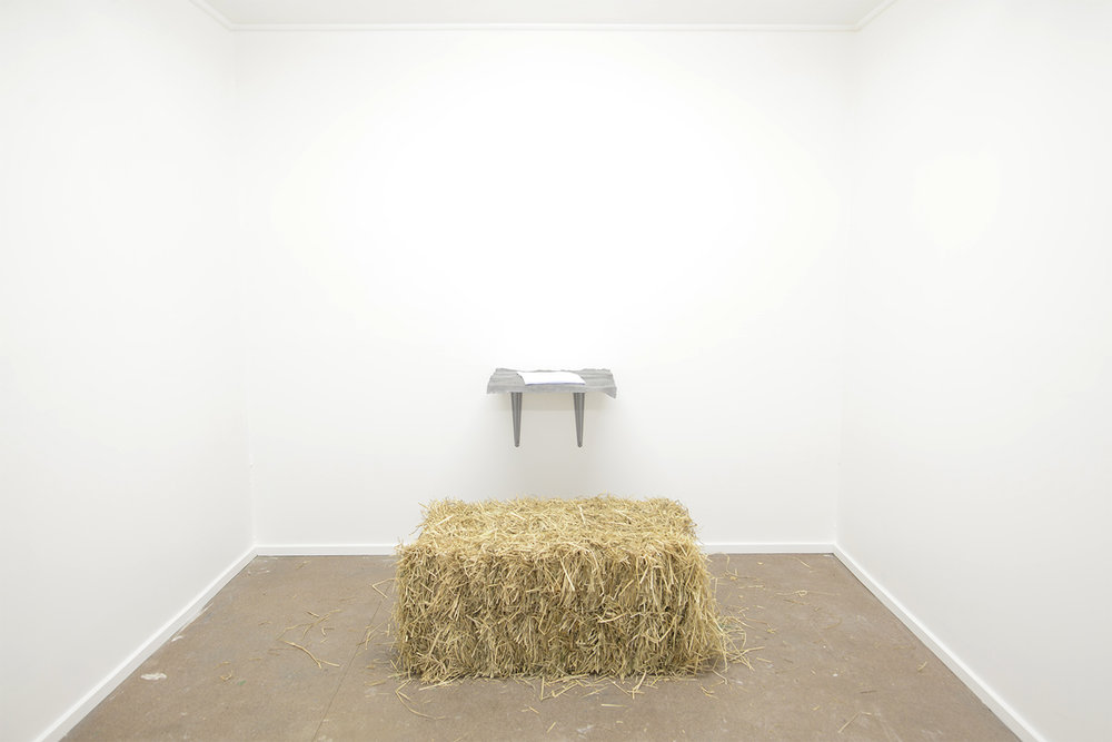 Spurs & Dust  2018 screenplay, lead shelf, hay bale, dimensions variable.