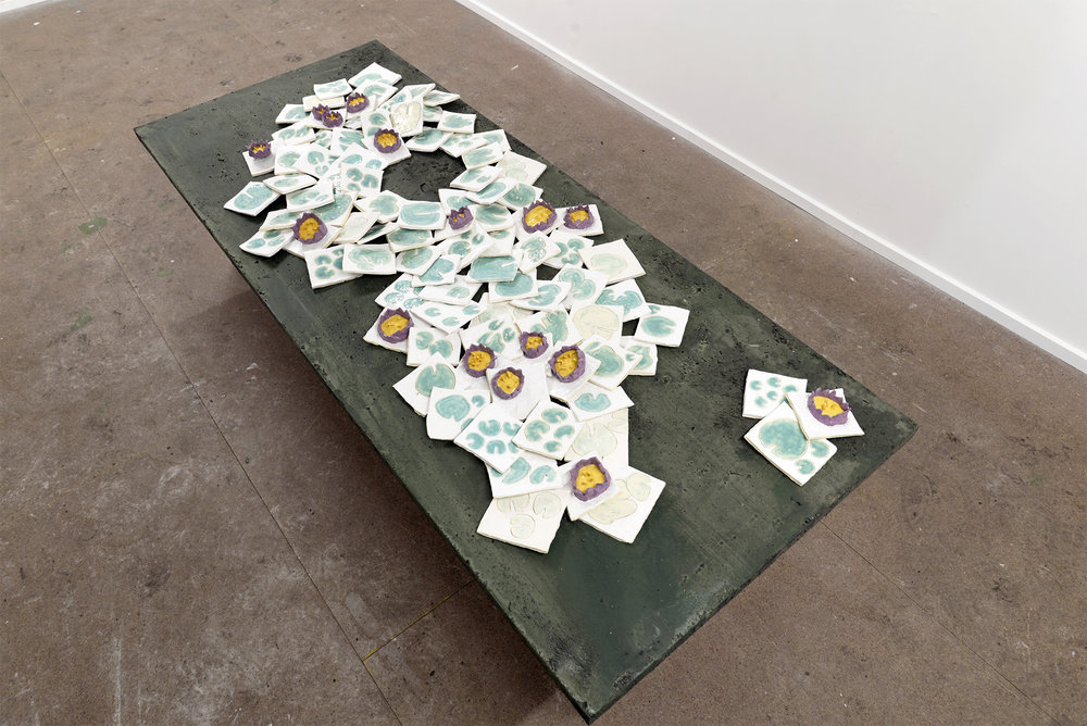 Making way  2018 dirty table, ceramic water lilies, ceramic lily pads, dimensions variable
