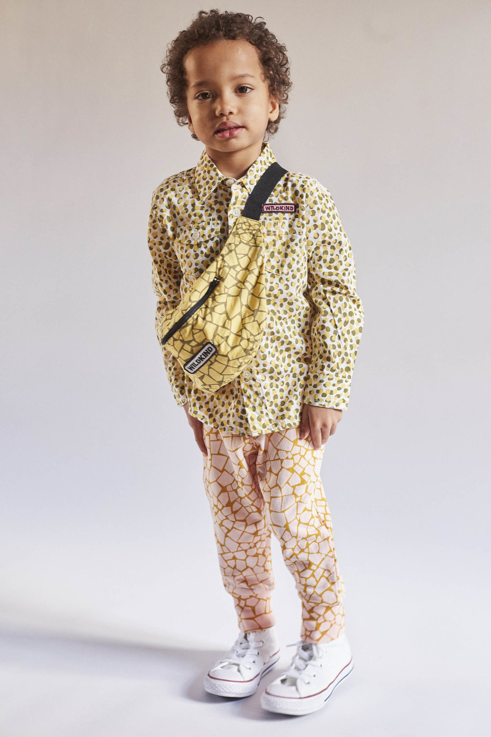 Oskar is 100 cm and wears Jay shirt in Cheetah camo, a size 104/110 .