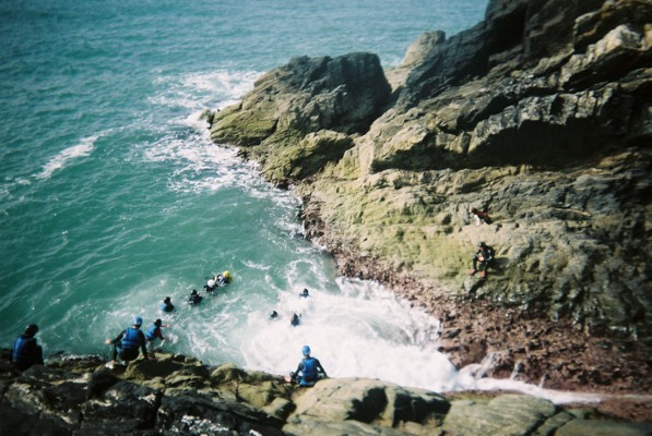 A group jumping into 'washing machine' on the West Coast of Wales