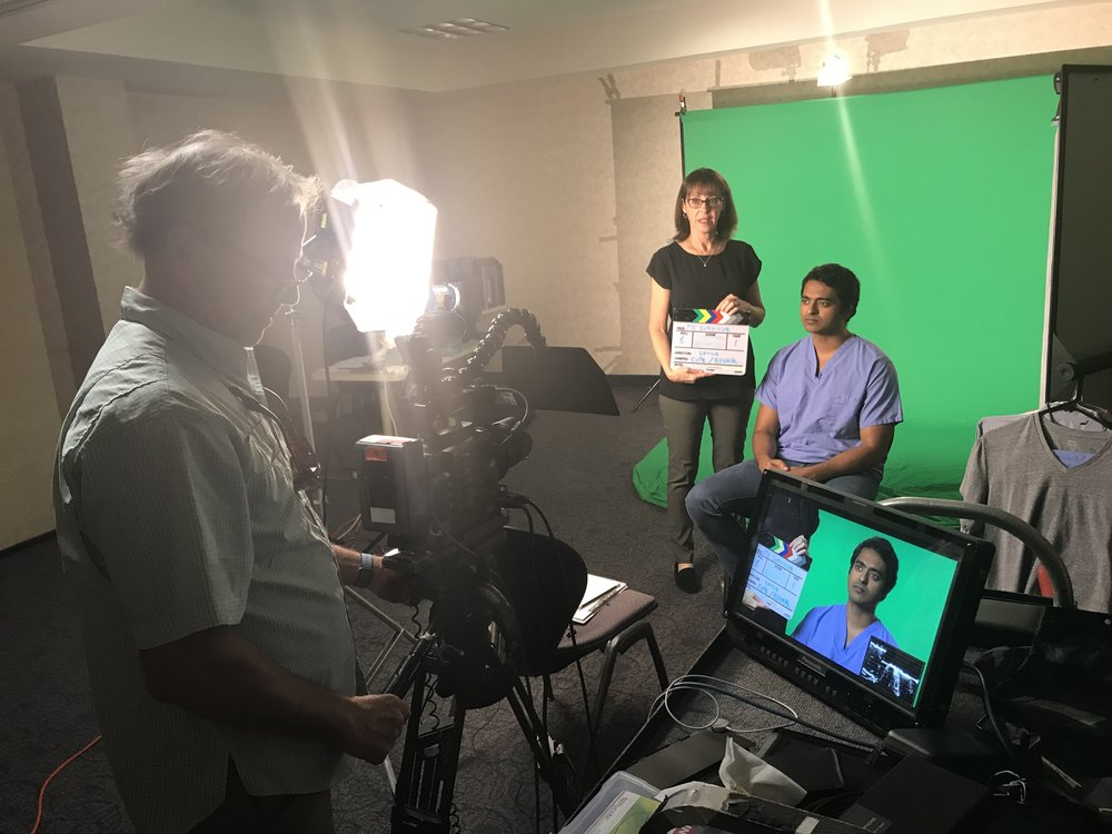 UM Medical School student Vibhu Chittajallu about to be interviewed. Senior Executive Producer Dr. Mindy Hersh gets the ball rolling on the day's shooting.
