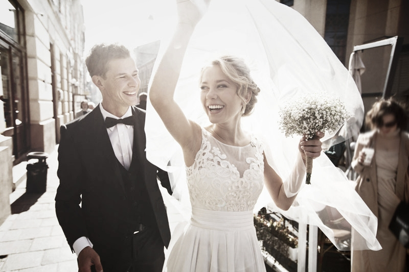 Happy young couple on their wedding day following teeth whitening treatment in Woking