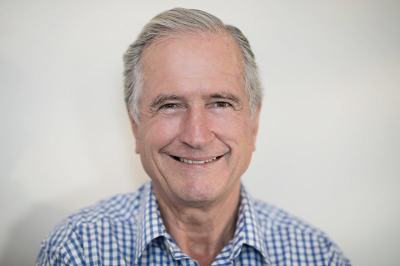Senior man smiling following restorative dentistry in Woking