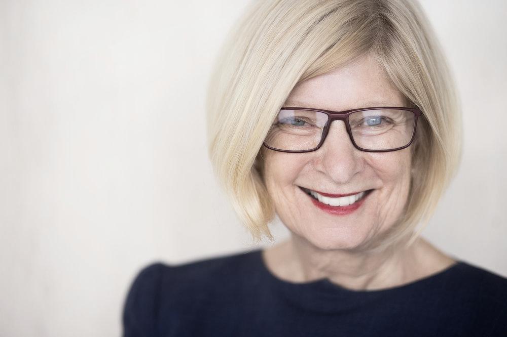 Lady in her 60s smiling after dental bridges