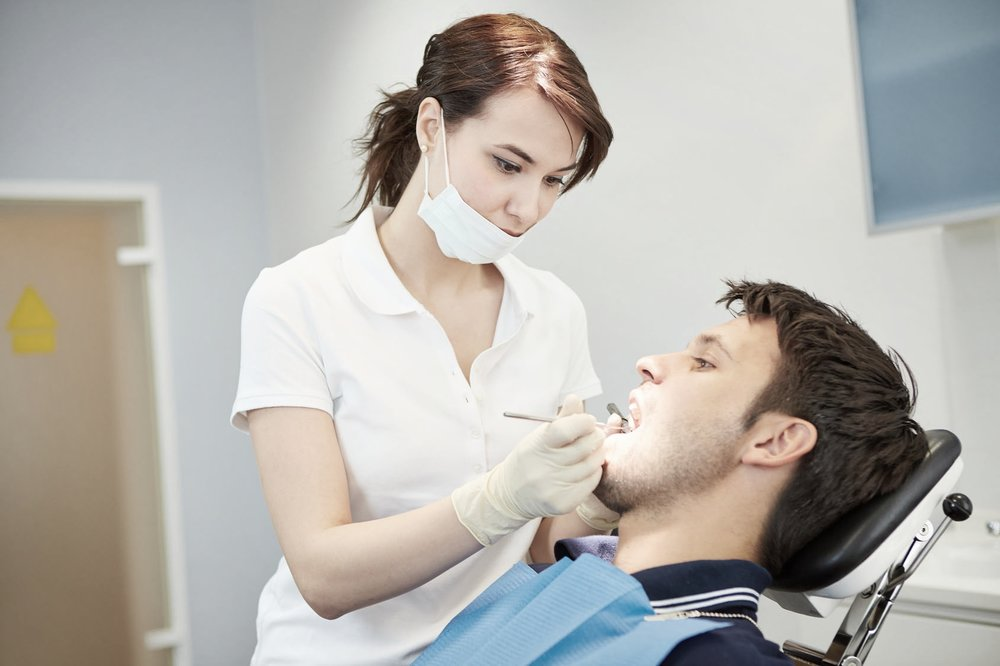 Man in dentist chair during dental hygiene appointment