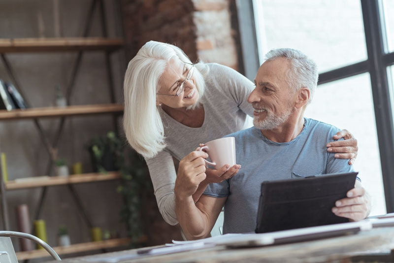 Older couple in kitchen after sinus lift treatment