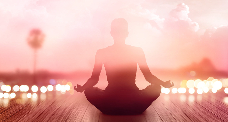 woman-was-meditating-in-sunrise-and-rays-of-light-on-landscape-soft-and-blur-concept.jpg