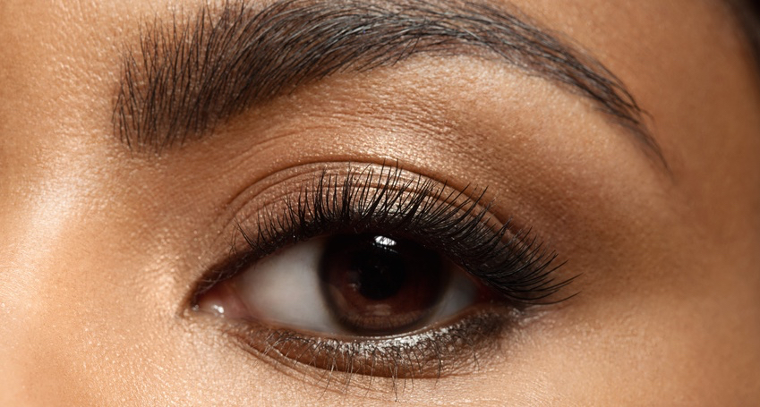 Close-up-of-make-up-eye-with-long-eyelashes-and-brown-eyebrows-of-black-woman.jpg