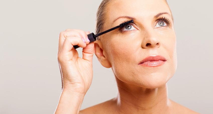 senior-woman-putting-mascara.jpg
