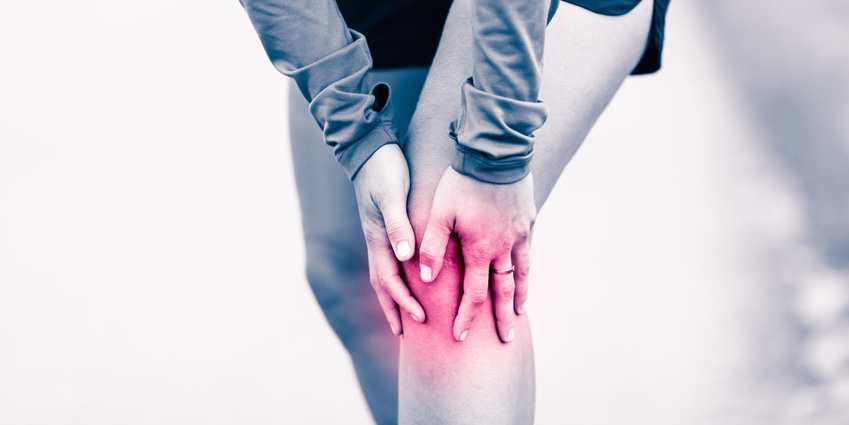 Knee-pain-woman-holding-sore-and-painful-leg.jpg