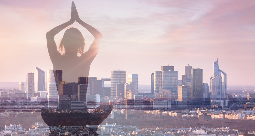 Double-exposure-of-woman-practicing-yoga-and-city-background.jpg