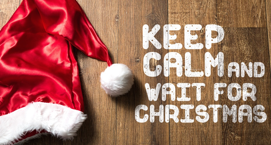 Keep-Calm-and-Wait-For-Christmas-written-on-wooden-background-with-Santa-Hat.jpg