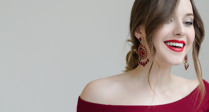 Portrait-of-young-smiling-beautiful-woman-in-dress-with-earrings.jpg