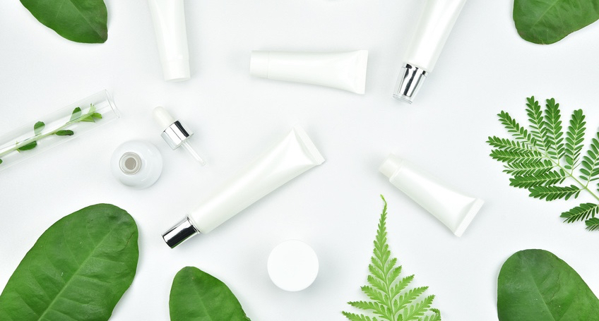 Cosmetic-bottle-containers-with-green-herbal-leaves-Blank-label-for-branding-mock-up-Natural-beauty-product-concept..jpg