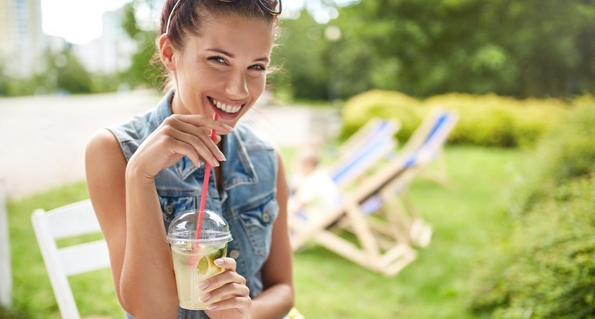 Lovely-young-smiling-woman-drinking-lemonade.-Summer-concept.jpg