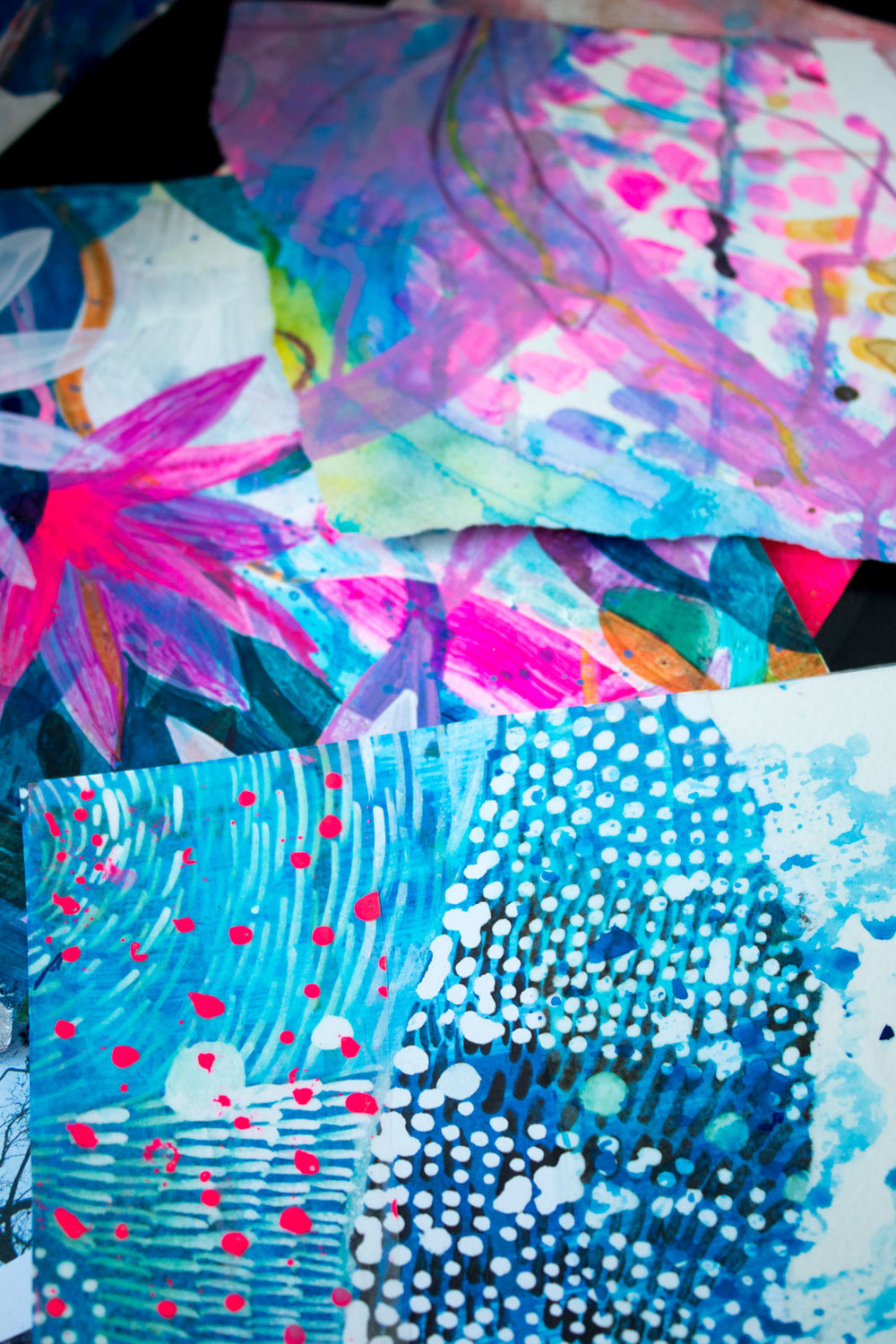 PATTERNED SAMPLE PAGES IN A PILE IN THE STUDIO