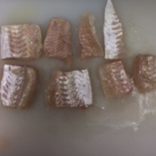 We then hand-cut the fish. -